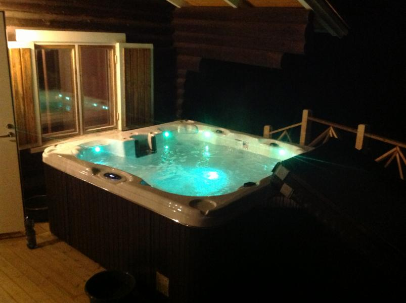 jacuzzi on the terrace of the sauna on the lake shore