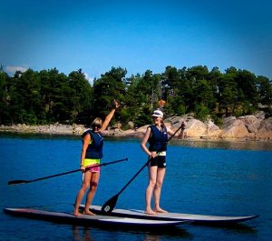 STAND UP PADDLING IN LAKE SCENERIES